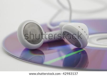 Headphones on cd, closeup on white background - stock photo