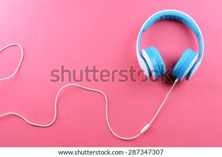 Headphones on pink background - stock photo