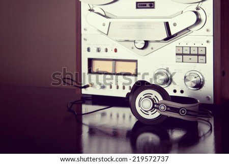 Headphones with Analog Stereo Open Reel Tape Deck Recorder Vintage Detailed Closeup - stock photo