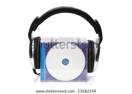 headphones with stack of cds - stock photo