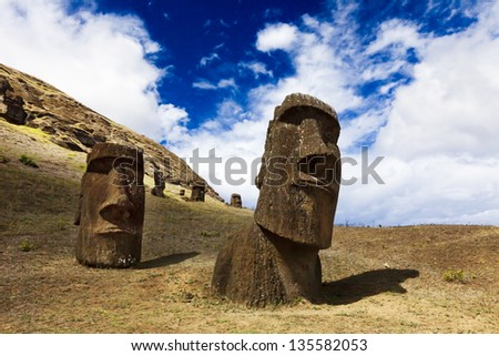 Heads of moais standing on a mountain in Easter Island - stock photo
