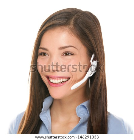 Headset customer service woman talking friendly smiling happy in call center on isolated on white background. Beautiful young mixed race Caucasian / Asian Chinese business woman working at hotline. - stock photo