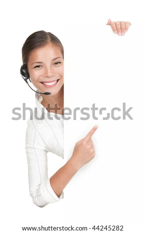 Headset woman from call center standing with billboard. Mixed race chinese / caucasian model isolated on white background. - stock photo