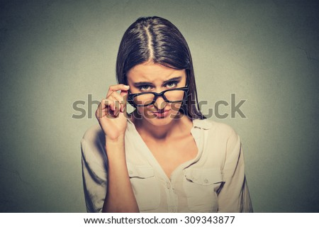 Headshot angry woman with glasses skeptically looking at you  - stock photo