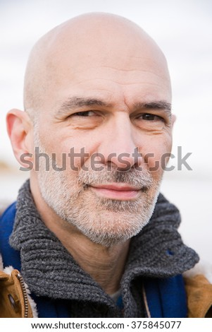 Headshot of a bald man - stock photo