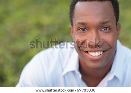 Headshot of a black man smiling - stock photo