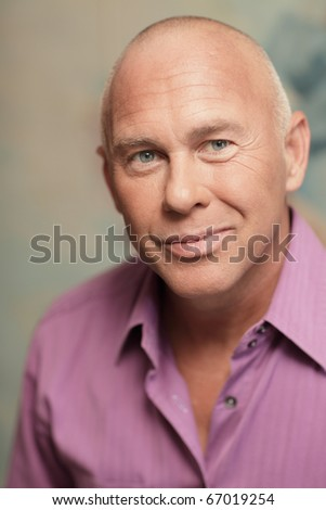 Headshot of a handsome man in a purple business shirt - stock photo