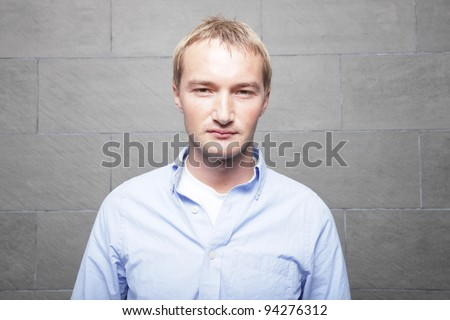 Headshot of a handsome Russian male model - stock photo