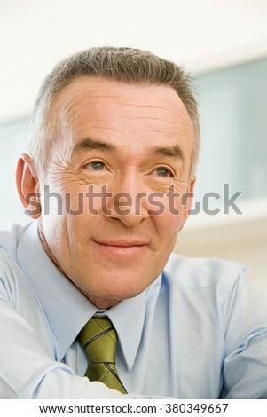 Headshot of a mature businessman - stock photo