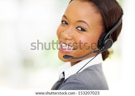 headshot of beautiful female african call center operator - stock photo
