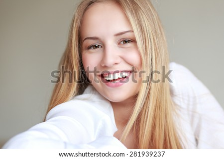 headshot of beautiful teen girl smiling with big toothy smile - stock photo