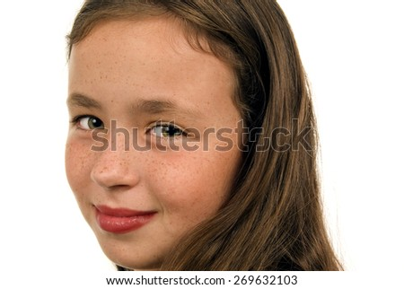 Headshot Of Smiling Little Girl With Green Eyes/ Headshot Of Little Girl Smiling Looking At Camera - stock photo