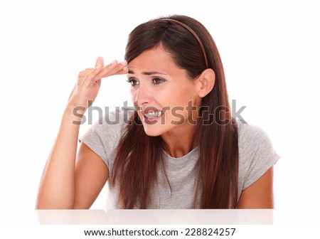 Headshot portrait of cute young woman with fail gesture looking to her right on isolated studio - stock photo