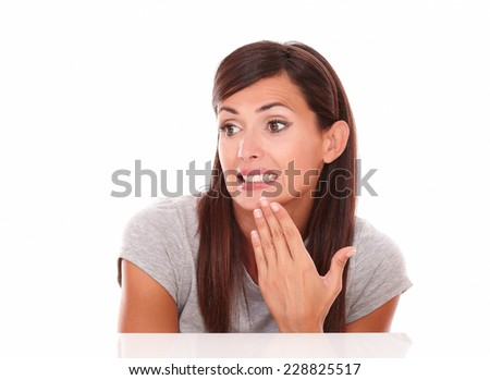 Headshot portrait of lovely latin woman with fail gesture looking to her right on isolated studio - stock photo