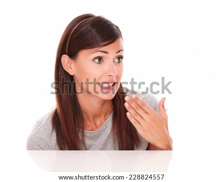 Headshot portrait of pretty hispanic girl with fail gesture looking to her left on isolated studio - stock photo