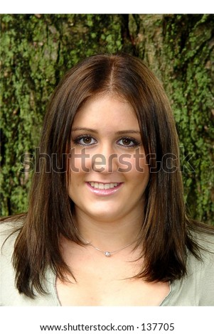 Headshot young  woman long brown hair brown eyes smiling - stock photo