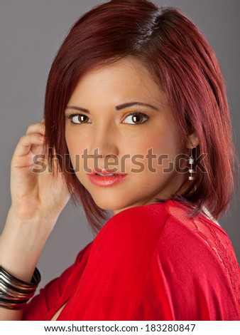 Headshots of an attractive woman in red - stock photo