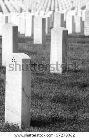 Headstones at the Arlington National Cemetery near Washington DC, black and white - stock photo