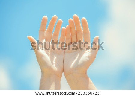 Healing hands on the sky - stock photo