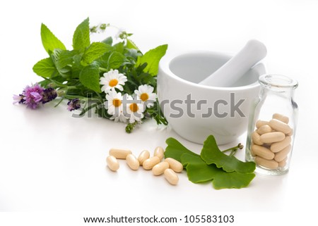Healing herbs and amortar. Alternative medicine concept - stock photo