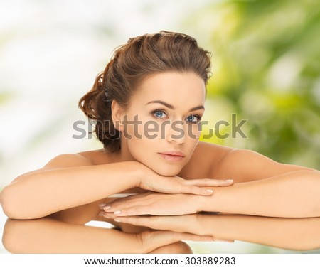 health and beauty concept - dreaming woman with updo and mirror - stock photo