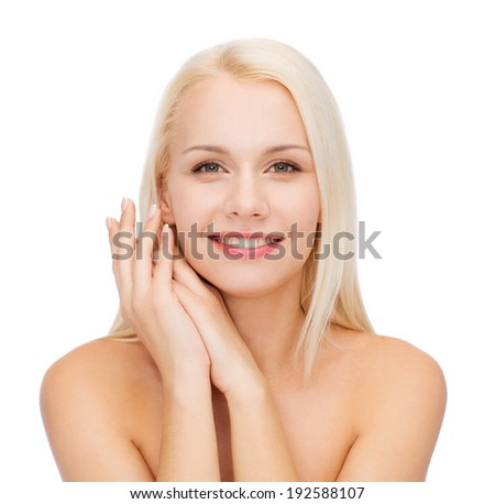 health and beauty concept - face and hands of happy woman - stock photo