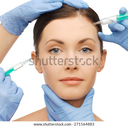 health and beauty concept - woman getting dermall fillers injection - stock photo