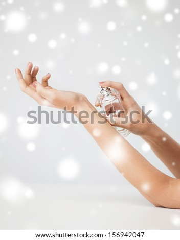 health and beauty concept - woman hands spraying perfume - stock photo