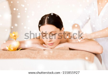 health and beauty concept - woman in spa salon getting massage - stock photo