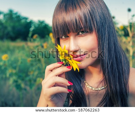 Health and beauty from mother Nature. Women smelling sunflower - stock photo