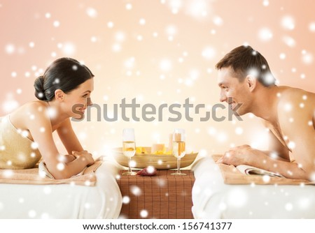 health and beauty, honeymoon and vacation concept - couple in spa salon drinking champagne - stock photo