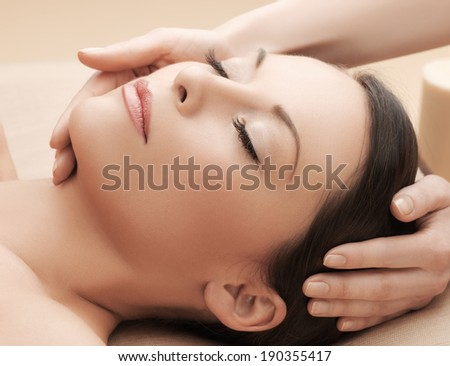 health and beauty, resort and relaxation concept - asian woman in spa salon getting massage - stock photo