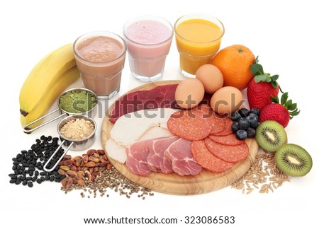 Health and body building high protein food with supplement powders, smoothies, dairy, fruit, grains, seeds, pulses and nuts over white background. - stock photo