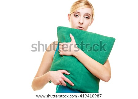 Health balance sleep deprivation concept. Sleepy tired teen girl with green pillow almost falling asleep. female student with lack of slumber isolated over white background - stock photo