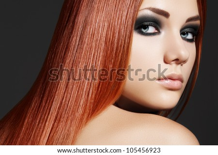 Health, beauty, wellness, haircare, cosmetics and make-up. Beautiful fashion hairstyle. Woman model with shiny straight long hair and evening make-up - stock photo