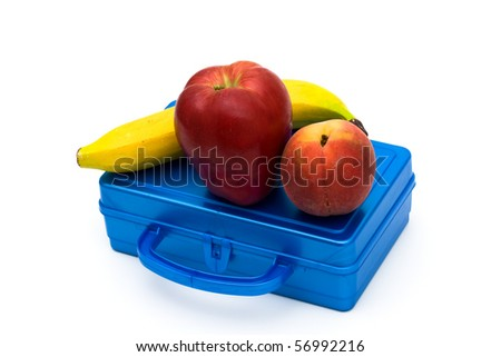 Health bunch of fruit on top of a lunchbox, Healthy School Lunch - stock photo
