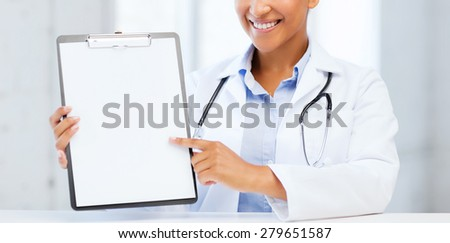 health care and medical concept - female doctor with stethoscope and blank prescription - stock photo