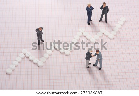 Health care costs. Businessmen negotiating medical investment and growth - stock photo
