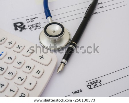 Health care costs. Stethoscope and calculator. Concept for health care costs or medical insurance. - stock photo