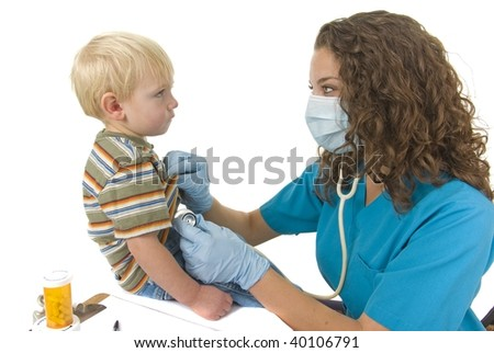 Health Care professional wearing gloves and mask checks toddlers breathing - stock photo