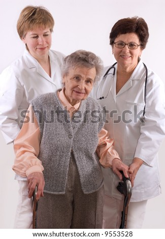 Health care workers and elderly woman needs help - stock photo
