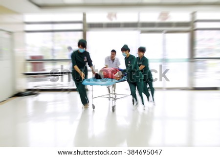 Health care workers rushed past emergency treatment hall, closeup of photo