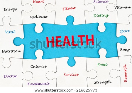 Health concept word cloud on group of jigsaw puzzle pieces - stock photo