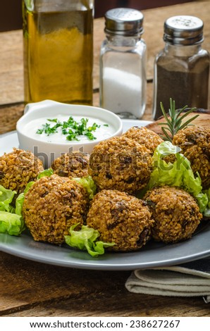 Health crunchy falafel with mint and garlic dip, naan bread with cumin and herbs - stock photo