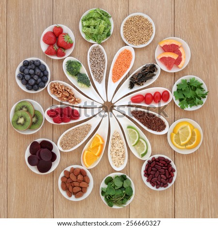 Health detox super food selection in porcelain bowls over oak wood background - stock photo