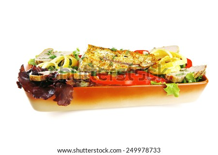 health dinner - atlantic light roast fish sea tuna served on plate with vegetables and lemon isolated on white background - stock photo
