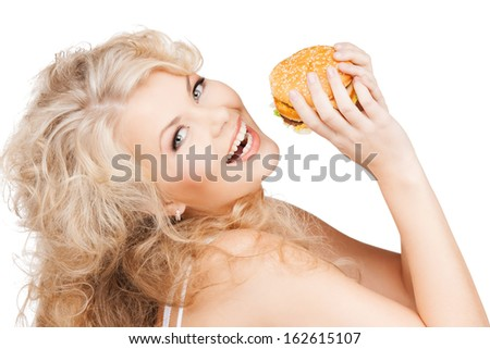 health, food, diet and beauty concept - beautiful happy woman with burger - stock photo