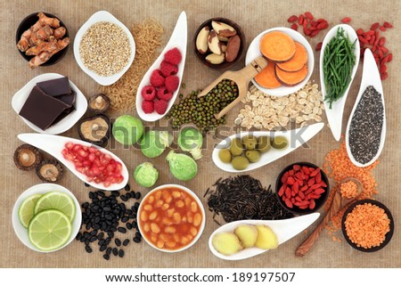 Health food selection over  brown paper background. - stock photo