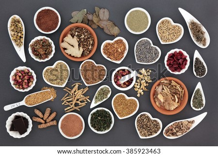 Health food with herb and spice selection for womens health over grey background. - stock photo