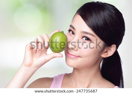 Health girl show lemon with smile face, health food concept, asian woman beauty - stock photo